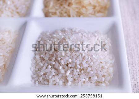 Different types of rice on plate close up - stock photo
