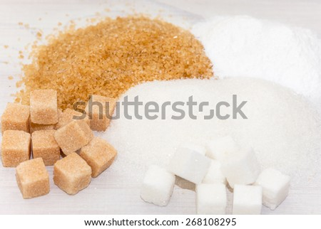 Different types of sugar - brown, white and refined sugar  - stock photo