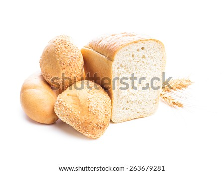 Different types of wheat bread and buns isolated on white