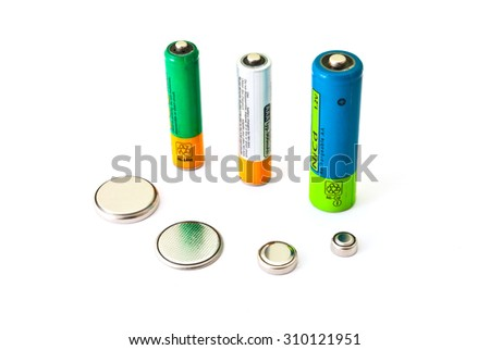 Different types various batteries on the white background - stock photo