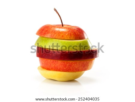 different varieties of apples cut into slices isolated on white background  - stock photo