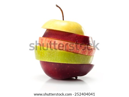different varieties of apples cut into slices isolated on white background