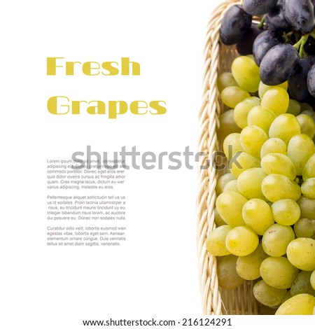 Different varieties of table grapes in wicker basket with copy space white background
