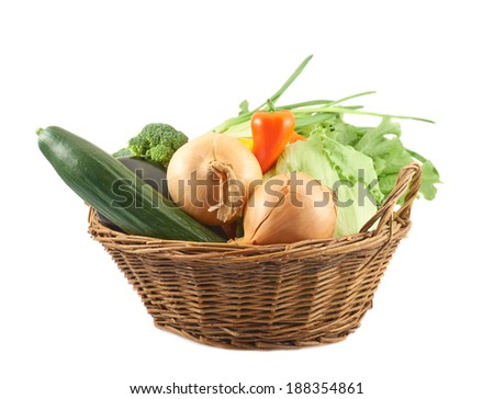Different vegetables in the basket isolated over the white background - stock photo