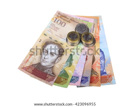 Different Venezuelan bank notes and coins. - stock photo