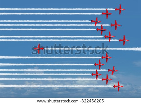 Different way business concept or going the opposite direction as a metaphor for individual thinking and new innovative ideas as airplanes flying as a group except for one jet. - stock photo