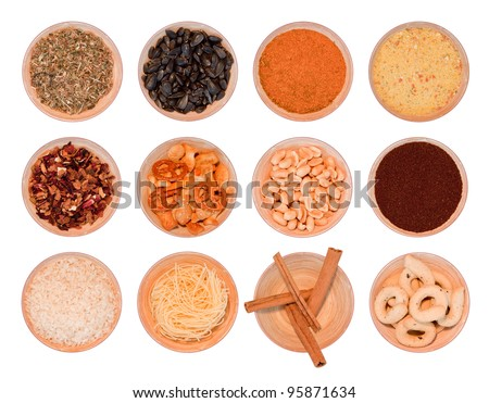 different wooden bowls with seasonning, tea, herbs, coffee, rice, cinnamon, noodles, brezels, peanuts