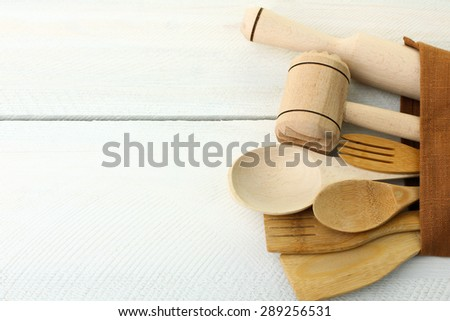 different wooden kitchen tools on the table with copy space