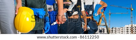 Different workers man closeup on building background - stock photo