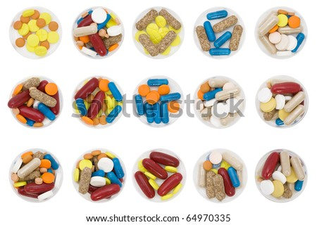 differently colored and shaped pills on white background - stock photo