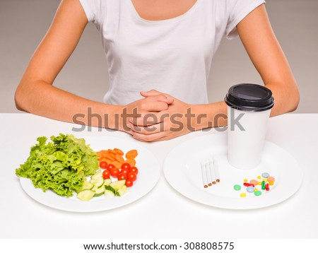 Difficult choice between healthy food and drugs. - stock photo