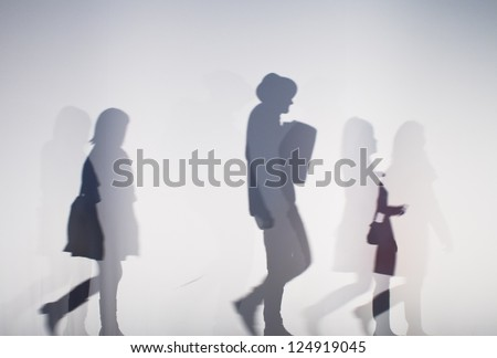 diffused silhouette of people through white cloth - stock photo