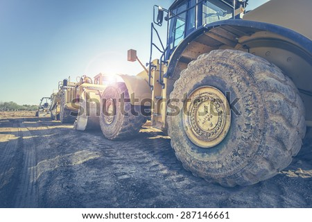 Digger bulldozer on construction site - stock photo