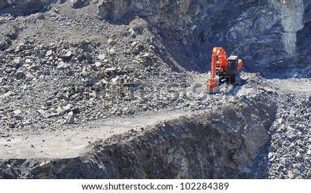 Digger in a stone mine - stock photo
