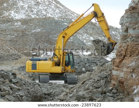 Digger in action - stock photo