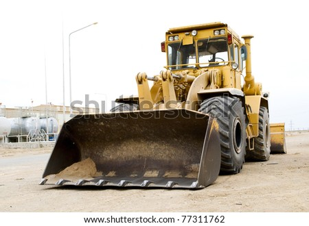 digger on industrial site - stock photo