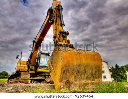 digger showing menacing strength, power, size, weight of this road construction vehicle - stock photo
