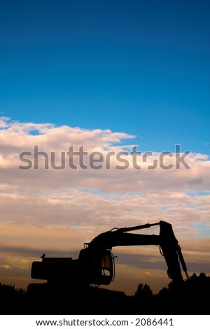 digger sunset silhouette - stock photo