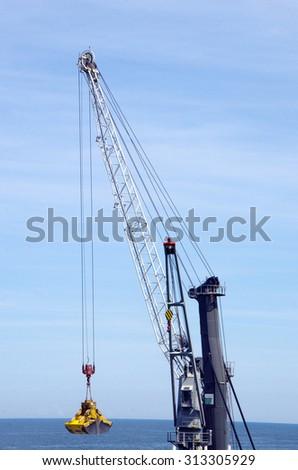 Digging Deep for Ideas-Gravel Scoop - stock photo
