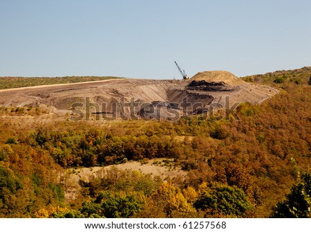 Digging for coal in W Virginia by removing mountain top - stock photo