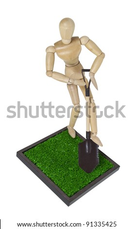 Digging into the grass with a metal shovel with wooden handle - path included - stock photo