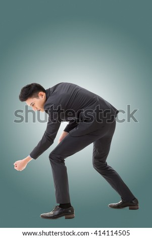 Digging pose or using shovel, full length portrait of Asian young business man. - stock photo