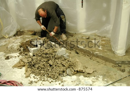 Digging up concrete - stock photo