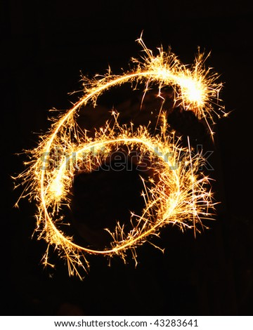 Digit 6 made of sparklers - stock photo