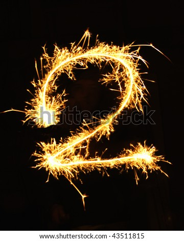 Digit 2 made of sparklers - stock photo