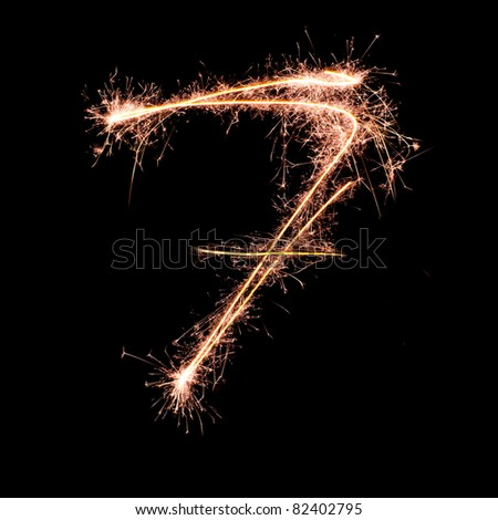 Digit 7 made of sparklers isolated on black. Real sparkler alphabet - stock photo