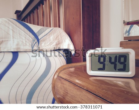 Digital Alarm Clock On Table In Bedroom.vintage Picture Style