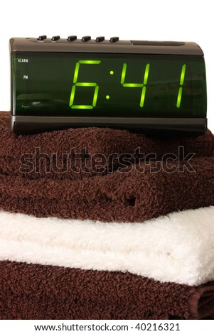 Digital alarm clock on towels
