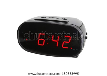 Digital alarm clock on white background - stock photo