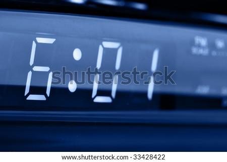 Digital alarm clock radio close-up (6 am) - stock photo