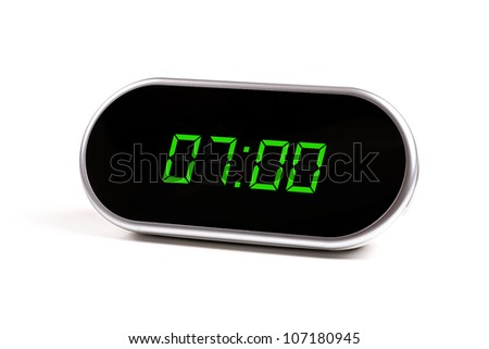digital alarm clock with green digits - stock photo