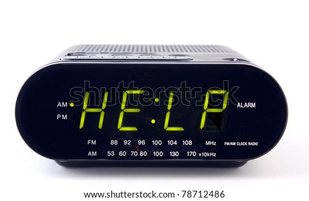 Digital alarm clock with the word HELP - stock photo