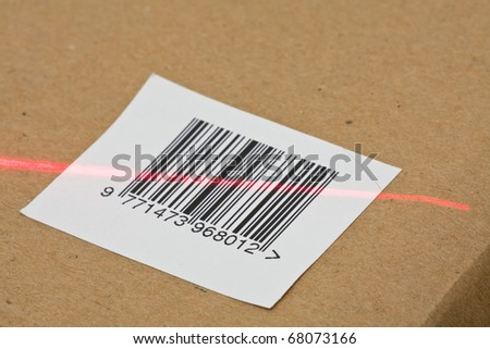 Digital bar code on carton scanned by laser - stock photo