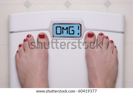 Digital Bathroom Scale Displaying OMG Message - stock photo