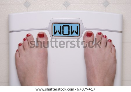 Digital Bathroom Scale Displaying WOW Message - stock photo