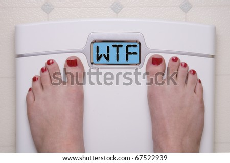 Digital Bathroom Scale Displaying WTF Message - stock photo