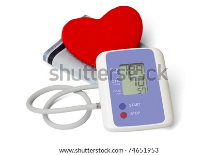 Digital blood pressure meter with love heart symbol on white background - stock photo