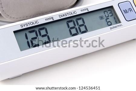 Digital blood pressure monitor close up - stock photo