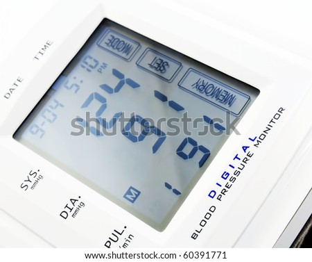 Digital blood pressure monitor. Close-up image. - stock photo