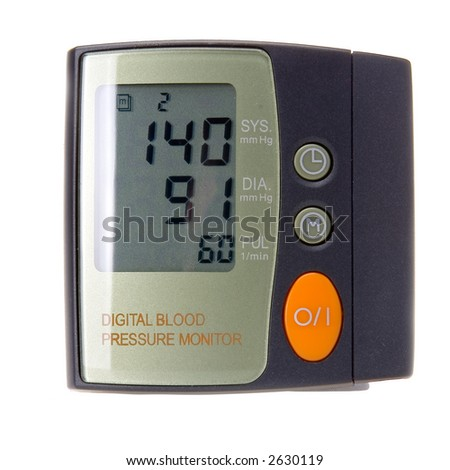 Digital blood pressure monitor isolated in white background - stock photo