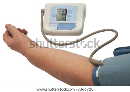 digital blood pressure monitor on a white background - stock photo