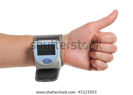 digital blood pressure on the hand - stock photo