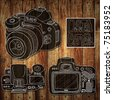 Digital camera drawing sketch on wood background - stock photo