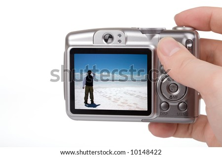 Digital camera in a hand. Photo on screen is my own shot