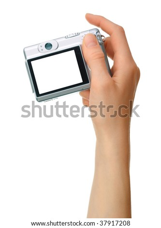 Digital camera in hand - stock photo
