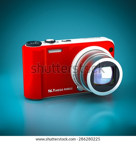 digital camera on a blue background - stock photo